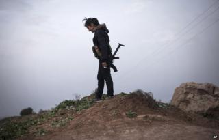 A female Kurdish fighter in northern Syria around 3 March 2014