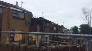 Several properties were damaged in the blaze after the fire spread from one house to several others