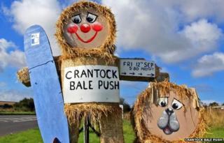 Baley the Bale Man and Baley the Bale Dog. Pic: Crantock Bale Push 2014