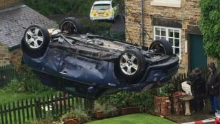 A car is lifted from a garden after a crash in Nether Haugh in May