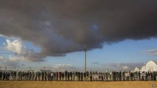 African migrants stand inside the Holot facility in Israel's Negev desert (17 February 2014)