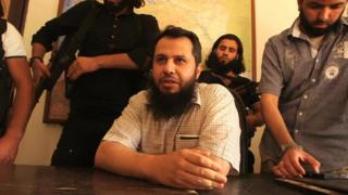 Hassan Abboud (seated) and members of the Islamic Front