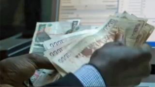 Someone counting money in Kenya