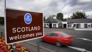 A 'Scotland Welcomes You' sign in Gretna at the border between Scotland and England