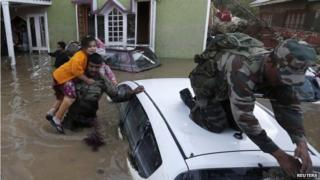 Indian army soldiers rescue a Kashmiri girl from her flooded house in Srinagar September 10, 2014