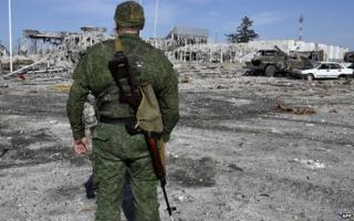 Rebel soldier and devastated Luhansk airport, 11 Sep 14