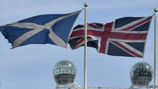 The Scottish saltire flag (L) and Union flag fly outside the Scottish Office, in central London August 28, 2014.