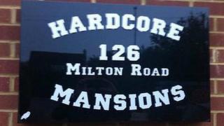 Hardcore Mansions sign