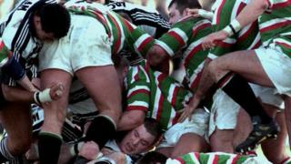 Rugby players in a tackle