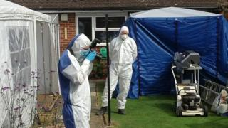 The garden of a house in Kings Close, Westcott, near Aylesbury, being searched by police