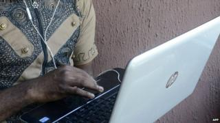 A Nigerian man on a laptop in Lagos - April 2014