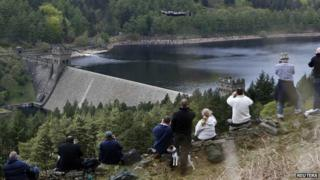 Photographers on dam bank