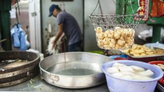 Street food in the Central district of Hong Kong on September 8, 2014. Pineapple buns and dumplings have been pulled from the shelves in Hong Kong