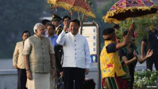 Mr Xi (left) wore a traditional Indian jacket gifted to him by Mr Modi (right) on Wednesday