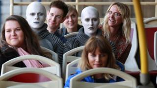 Actors dressed as aliens