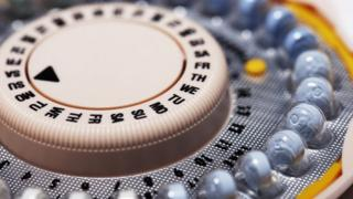 A birth control pill container.