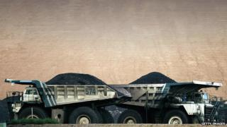 Coal trucks pass each other at BHP Billiton's Mt Arthur coal mine