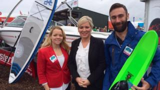Michelle O'Neill (centre) with Jonathan Crawford and Samantha Crawford from Mastercraft Ireland