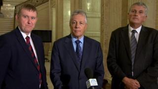 Mr Robinson with Mervyn Storey and Jim Wells