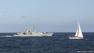 The Irish naval vessel - the LÉ Niamh, sails alongside the detained yacht Makayabella