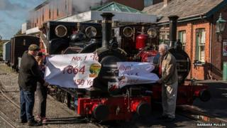 The engine broke through a 150th birthday banner on Wednesday