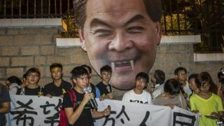 Students march to the Government House in Hong Kong on September 25, 2014 to push the Chief Executive Leung Chun Ying (picture) to acknowledge their grievances