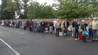 People queuing for water