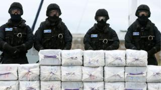 Irish navy officers stand guard over the cocaine haul