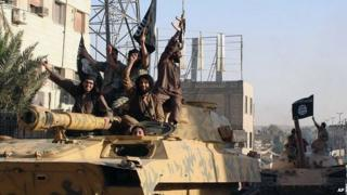 Members of Islamic State group parade in Raqqa, Syria