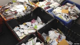 Pieces of mail that a New York City mailman allegedly stashed away in his home and car over nearly a decade are seen in an undated picture released by the U.S. Attorney's office in New York 26 September 2014