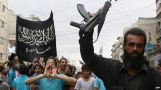 Supporters of al-Nusra Front protest in Aleppo, Syria. 26 Sept 2014