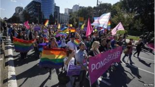 Gay rights and human rights activists march