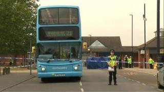 Police cordon around a bus
