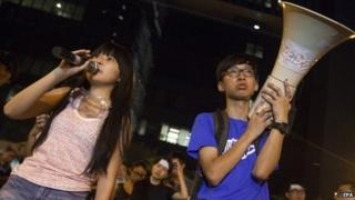 Students address the crowd outside the Hong Kong government offices outside the Hong Kong government offices on the second day of the mass civil disobedience campaign Occupy Central, Central District, Hong Kong, China, on 29 September 2014.