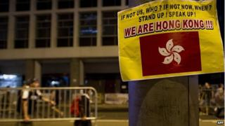 A sign is displayed during a pro-democracy protest in the Central district of Hong Kong on 30 September 2014.
