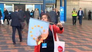 Woman burning flag at Conservative party conference