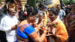 Former government minister Janardhan Poojary (far left) in attendance as the two Dalit women are welcomed into the priesthood