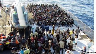 Rescue migrants aboard navy frigate Euro near Italian island of Lampedusa