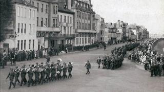 German troops marching along Guernsey's seafront during the occupation during World War Two