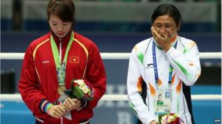 Sarita Devi (right) refused to take her bronze medal on Wednesday