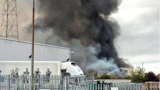Thick smoke emitting from an industrial unit
