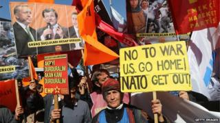 Protesters demonstrate in front of the Turkish Parliament in Ankara