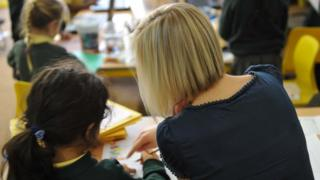 Child with teaching assistant