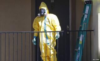 Man in protective suit in Dallas