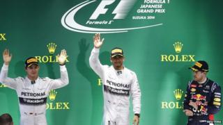 Lewis Hamilton (centre), his team mate Nico Rosberg (left) and Sebastian Vettel (right).
