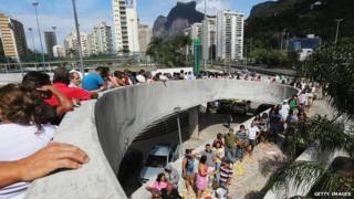 Brazilians wait in line to enter a polling station in the Rocinha favela, or community, on the day of national elections