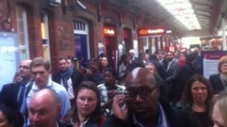Delayed train commuters at Reading station
