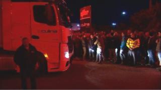 Protestors block a lorry
