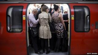 Commuters pack on to a Tube