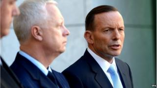 Australian Prime Minister Tony Abbott (R) and Australian Defense Force Chief Air Marshal Mark Binskin (C) during a press conference at Parliament House in Canberra, Australia, 3 October 2014.